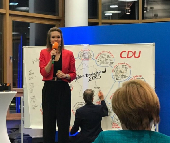 Readie's Valerie Mocker pitches digital policy ideas to German chancellor  Angela Merkel.